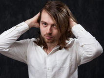 Man with long hair stiring it up Royalty Free Stock Image