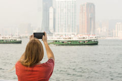 Man with long Hair taking Pictures. In Central Island Hong Kong Stock Image