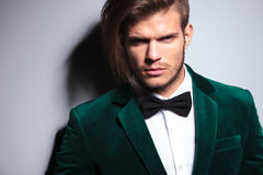 Man with long hair wearing an elegant green suit and neck bow t Royalty Free Stock Images