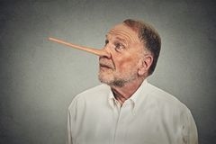 Man with long nose looking up. Liar concept Stock Image