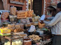 Man In Long-sleeved Shirt Standing Beside Food Stall Royalty Free Stock Photos
