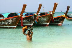 Man and long tail boats in Thailand Royalty Free Stock Images