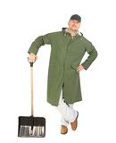 Man in long vest with shovel Stock Photo