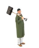 Man in long vest with shovel. Royalty Free Stock Image