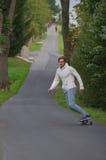 Man longboarding Royalty Free Stock Images