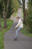Man longboarding Royalty Free Stock Photography