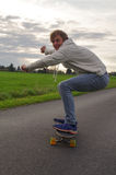 Man longboarding Stock Image