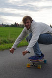 Man longboarding in funny position Royalty Free Stock Images
