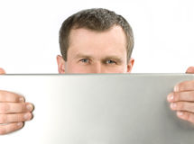 Man look. Smart man look through laptop, white background Stock Photography