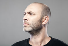Man look into the distance isolated on gray Stock Photo