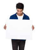 Man look down on white board Stock Photo