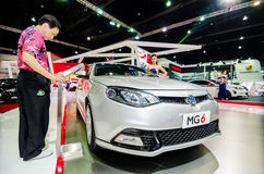 Man look infomation of car  at Thailand motor show. Royalty Free Stock Photo