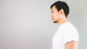 A man look straight to the side. Stock Images