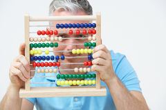 Man Looking Through Abacus Stock Images