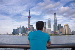 Man looking across the Huangpu River Stock Images