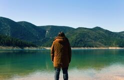 Man looking across a lake Stock Photography