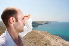 The man looking afar Stock Images