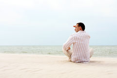 Man looking afar near the sea. Young man looking afar near the sea Royalty Free Stock Photos