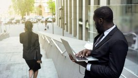 Man looking affectionately at attractive business lady passing by, distracted royalty free stock image