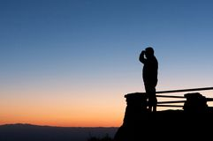 Man looking at amazing view at sunrise Stock Image