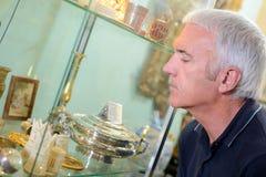 Man looking at artifacts Stock Image