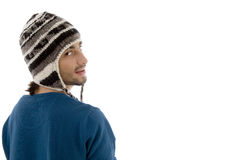 Man looking aside and wearing woolen cap Stock Photo