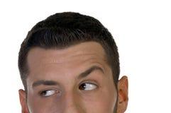 Man looking askance Stock Photography