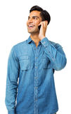Man Looking Away While Answering Smart Phone Royalty Free Stock Photography