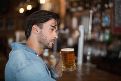Man looking away while drink beer at pub Royalty Free Stock Photo