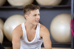 Man Looking Away In Health Club. Young man looking away while resting in health club stock image