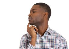 Man looking away thinking deeply Royalty Free Stock Image