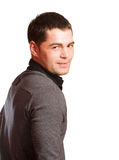 Man looking back. Young man's looking back isolated royalty free stock photos