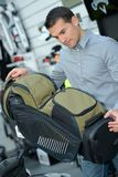Man looking at backpacking bag. Bag stock photo