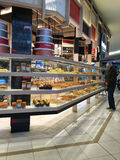 Man looking at bakery display. Man looking at bakery window display royalty free stock image