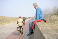 Man looking at the bicycles Royalty Free Stock Image