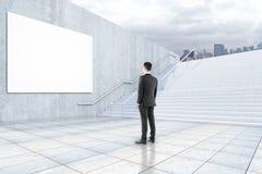 Man looking at billboard Stock Image