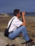 Man looking through binoculars Royalty Free Stock Images