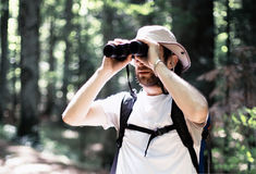Man looking through the binoculars Stock Photo