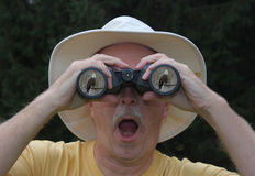 Man Looking Through Binoculars Royalty Free Stock Photography