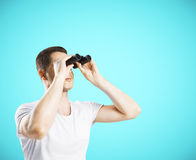 Man looking through binoculars Royalty Free Stock Image