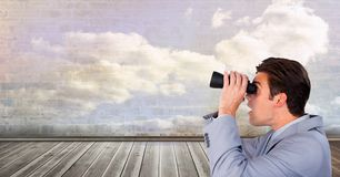 Man looking through binoculars. Digital composite of Man looking through binoculars Royalty Free Stock Photos