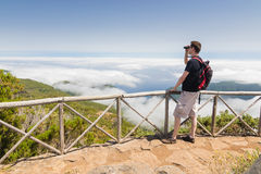 Man looking into binoculars in Madeira viewpoint Royalty Free Stock Images