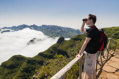 Man looking into binoculars in Madeira viewpoint Stock Images
