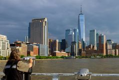 Man looking through binoculars in New York city Manhattan. Skyline the financial district the Freedom Tower tourism skyscraper travel tourist usa cityscape royalty free stock photo