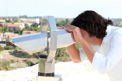 Man looking through binoculars Royalty Free Stock Photos