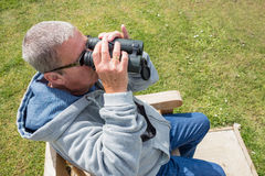 Man looking with binoculars Royalty Free Stock Images