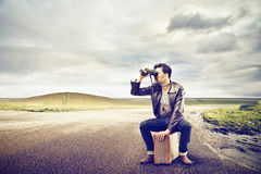 Man looking through a binoculars Stock Photography