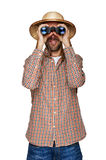 Man looking binoculars with traveler hat isolated over white bac. Kground Royalty Free Stock Photo