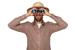 Man looking binoculars with traveler hat isolated over white bac. Kground Royalty Free Stock Images