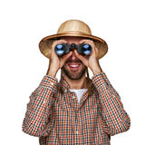 Man looking binoculars with traveler hat isolated over white bac. Kground Stock Photo